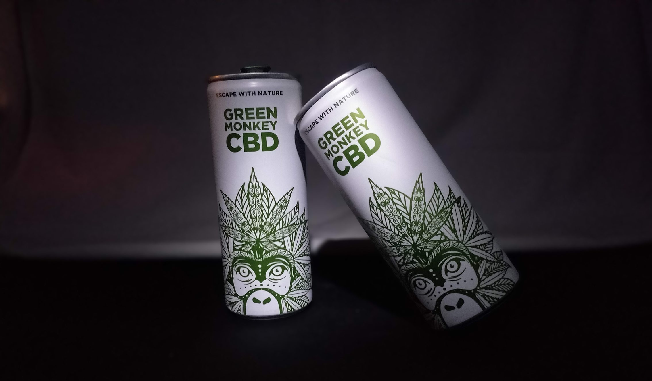 Two cans of Green Monkey CBD