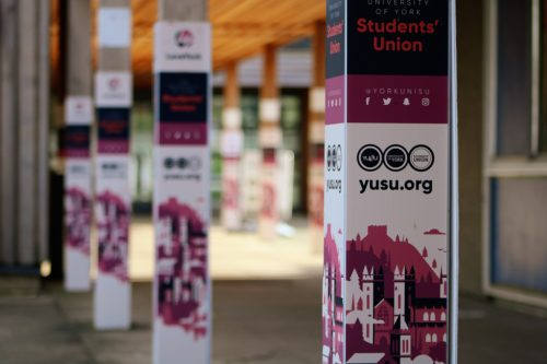 Poles in YUSU buildings with banner surrounds