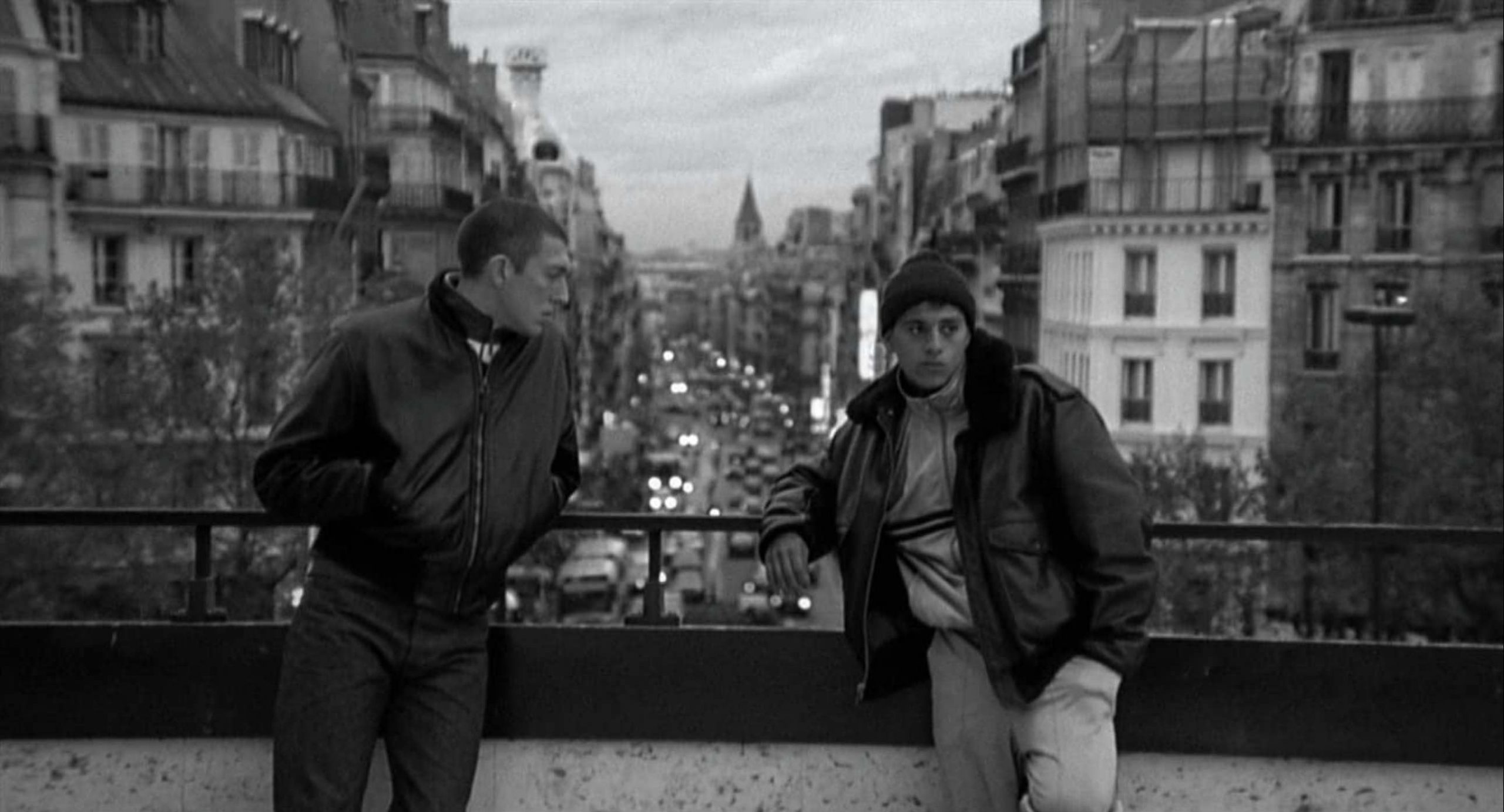 Image captured from film LaHaine, showing two young men leaning against a bridge in Paris